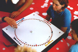 image of people playing transacoustic board game